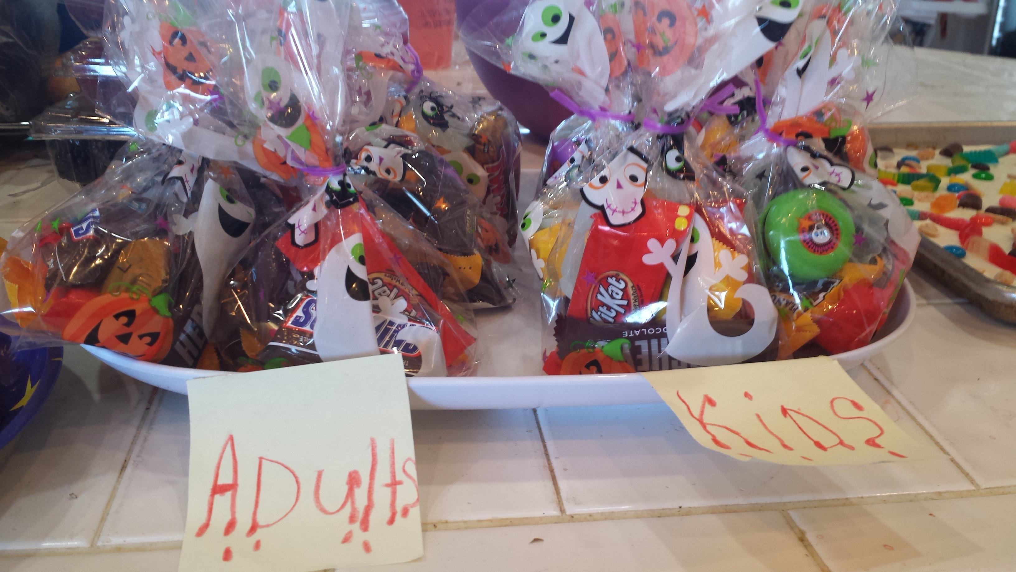Party favors displayed nicely in Halloween Treat bags.  We sectioned out into Adults and Kids for special prizes.