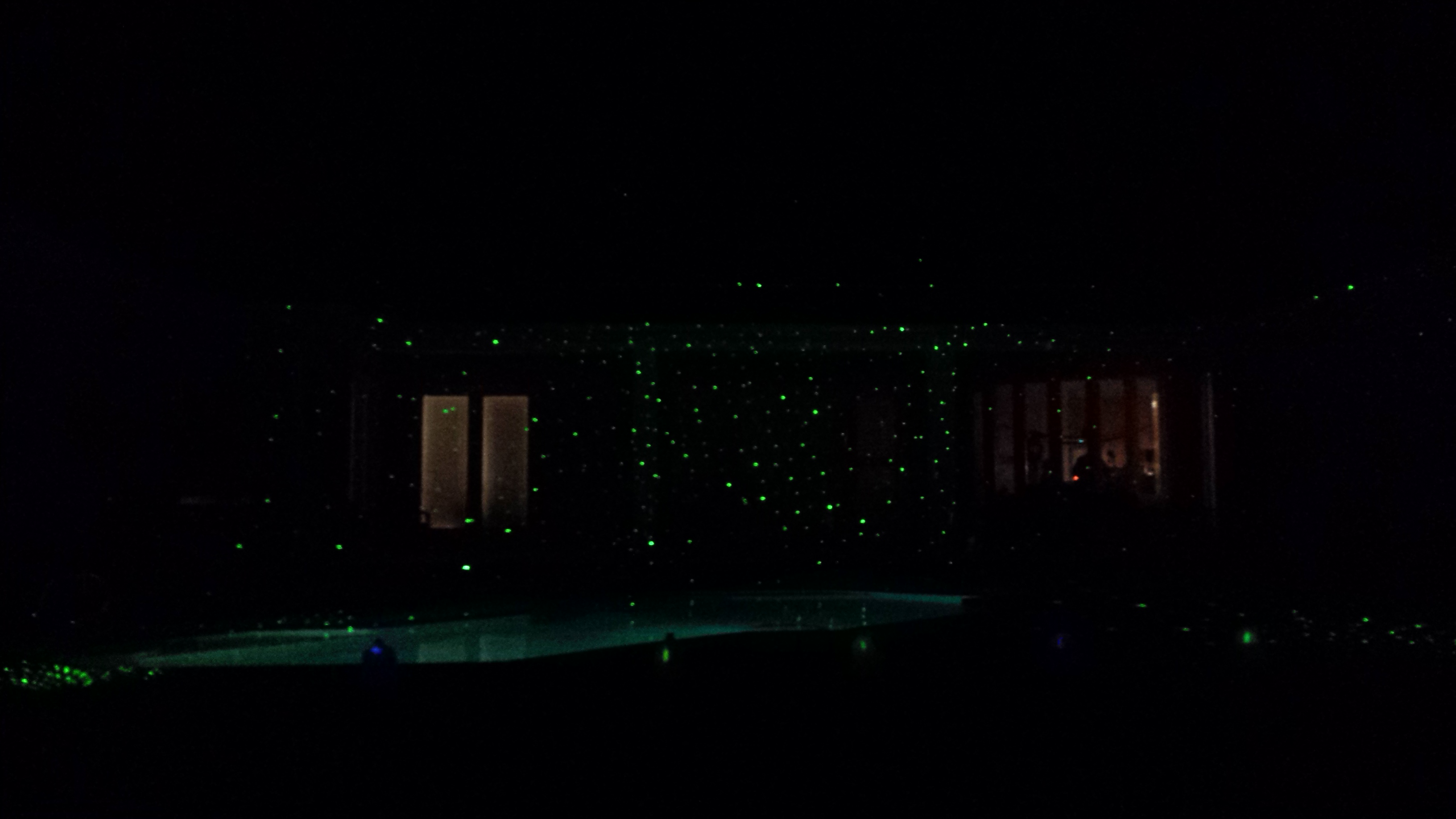 Our pool was lit up with an awesome light show, made possible by a gadget called Star Shower Laser Light.